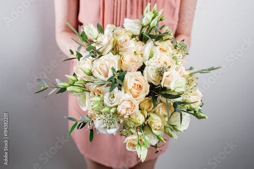 In de dag Bloemen beautiful luxury bouquet of mixed flowers in woman hand. the work of the florist at a flower shop