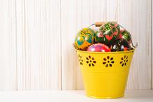 Easter Eggs In Bucket On White...