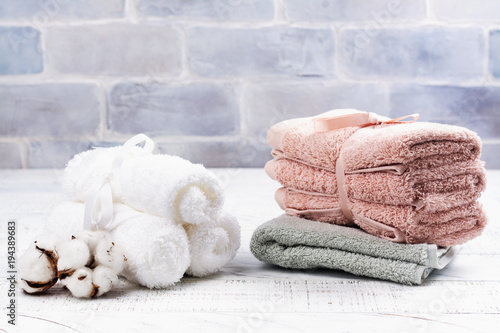 Tuinposter Spa SPA or welness concept with cotton towels, soap and sea salt