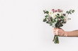 canvas print picture - cropped shot of woman holding beautiful bridal bouquet isolated on grey