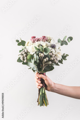 Wall Murals Floral close up view of arranged grooms shoes and accessories on wooden surface