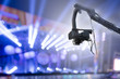 canvas print picture - video camera on crane  covering event on stage