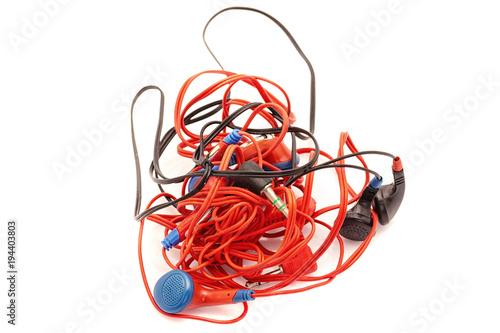 Obraz na plátně tangled various headphones on white
