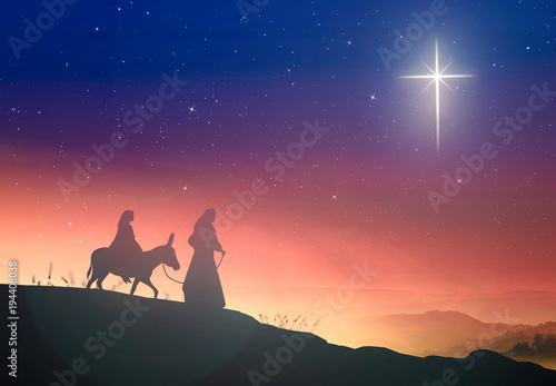 Foto Christmas religious nativity concept: Silhouette pregnant Mary and Joseph with a
