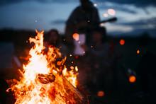 Spark Flying From Beach Bonfire In Summer