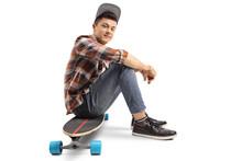 Teenage Skater Boy Sitting On ...