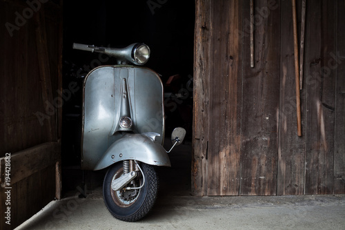 Spoed Foto op Canvas Scooter Barn find of old, rusty italian scooter in a hut