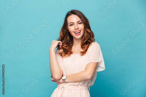 Happy young lady over blue background.