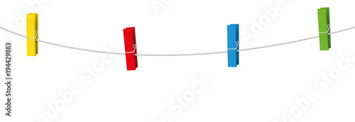 Fotografía  Four colored clothes pins on a clothes line rope holding nothing.