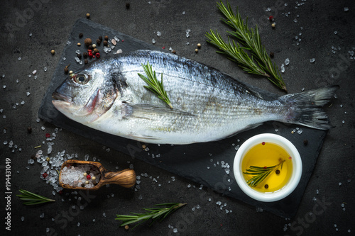 Fotografie, Obraz  Dorado and ingredients for cooking