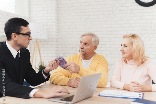 Mature couple with old man