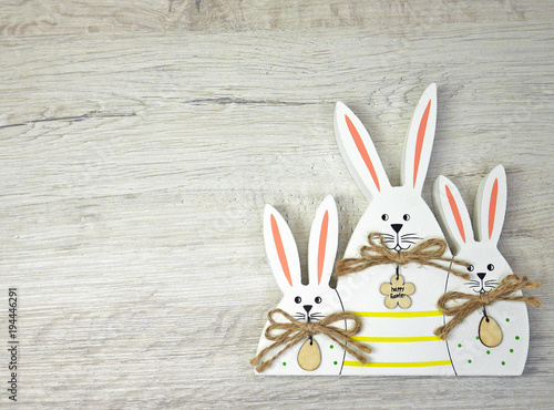 Three Bunny on wooden background for happy easter