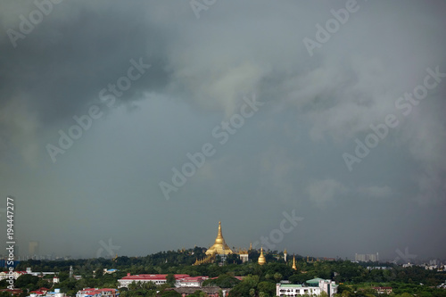 Obraz na plátně  Top view on the Shwedagon Pagoda in Yangon during rainy day, Myanmar