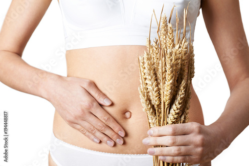 Poster Graine, aromate Close Up Of Woman Wearing Underwear Holding Bundle Of Wheat And Touching Stomach
