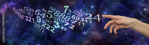 Seek the advice of a Numerology Expert  - female hand pointing at a flow of random numbers on a dark blue deep space starry night   background