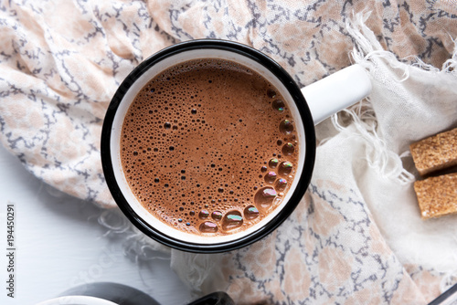 A cup of hot chocolate and colorful bubbles. Close-up, horizontal