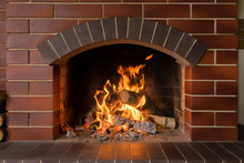A Brick Fireplace In Which A F...