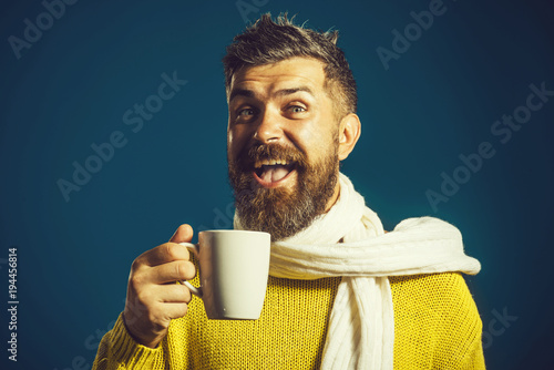 Poster The Season, drinks and people concept - happy smiling young man with cup drinking hot tea in winter.