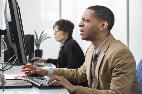 Business man working on computer looking frustrated, upset Tapéta, Fotótapéta