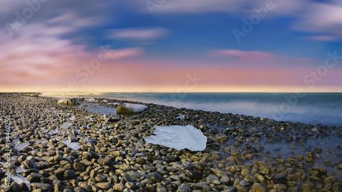 Staande foto Strand Ice on rocky beach in Romanshorn, Switzerland
