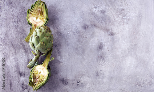 Photo artichokes on grey background. fresh organic artichoke flower.