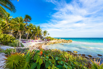 FototapetaRecreation at paradise beach resort with turquoise waters of Caribbean Sea at Tulum, close to Cancun, Riviera Maya, tropical destination for vacation, Mexico