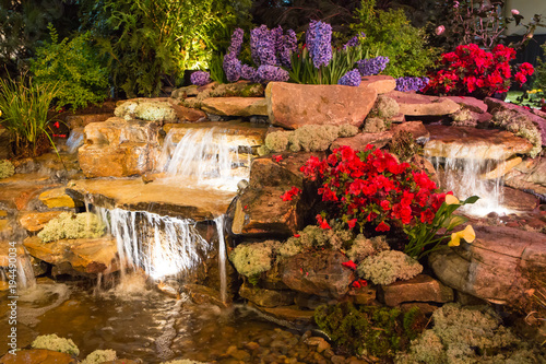 Foto op Canvas Watervallen Brightly Lit Waterfall and Pond