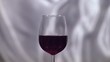 Red wine in a glass on a grey background