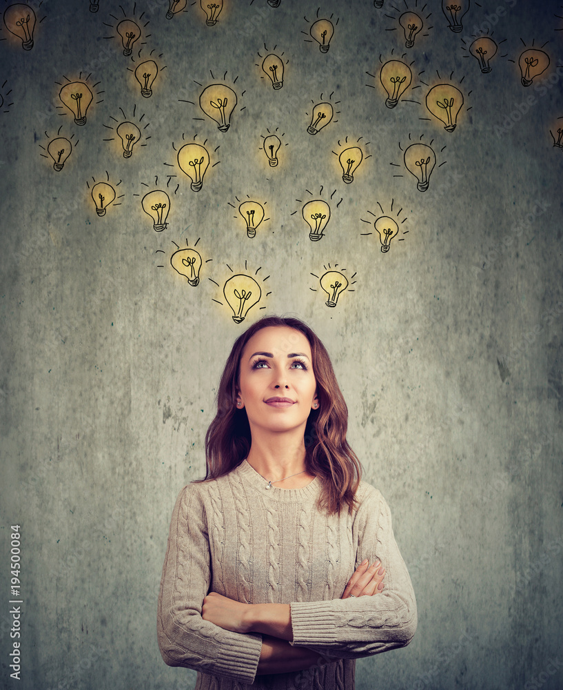 Fototapety, obrazy: woman contemplating and looking up has many bright ideas