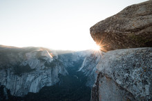 A Beautiful Sun Star Indicates Sunrise Over Yosemite's Glacier Point