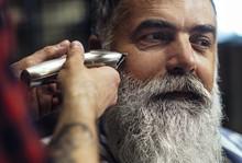 Man Having Beard Shaving