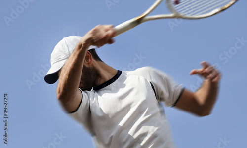 Fototapeta male tennis player in action, motion blurs
