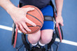Active disabled athlete practicing wheelchair basketball