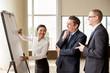 Three Business People Joking at Meeting