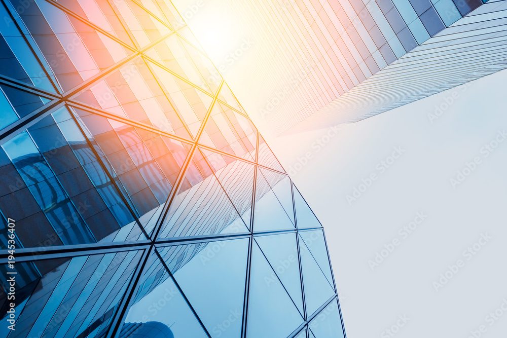 Fototapeta Reflections of modern commercial buildings on glasses with sunlight
