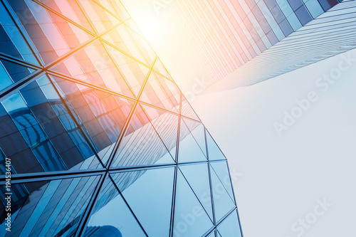 Fototapeta Reflections of modern commercial buildings on glasses with sunlight obraz