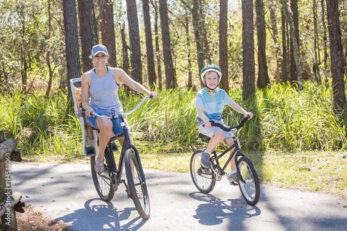 Fotografie, Obraz  Family on a bike ride together outdoors on a sunny day