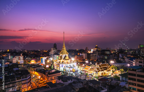 Deurstickers Bangkok Top view cityscape Wat Trimit in chinatown or yaowarat area at twilight time Bangkok Thailand.