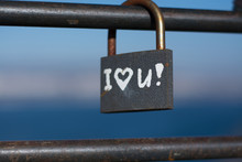 A Symbolic Love Padlock Fixed To The Railings On A Bridge