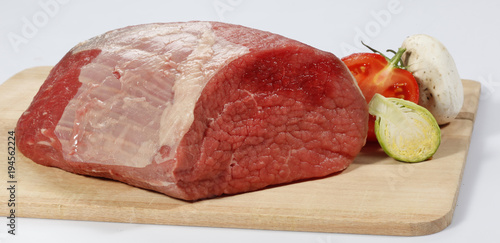 Staande foto Vlees fresh raw red beef meat big steak chunk on wooden cut board isolated over white background