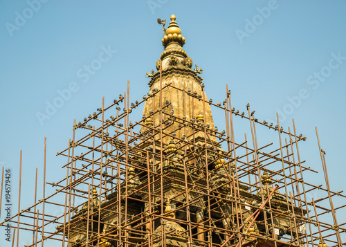 Pigeons on some scaffolding around Krishna temple on Patan Durbar Square, in Patan, Nepal. The temple was damaged by the April 2015 Nepal earthquake.