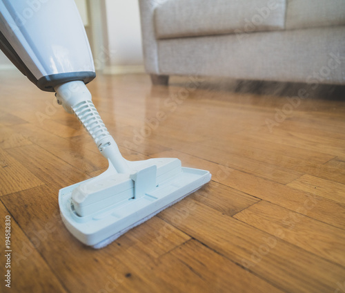 Fototapeta Cleaning the floor with a dry steam cleaner. obraz