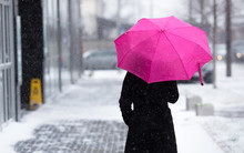 Woman With Umbrella On Snowy Day.