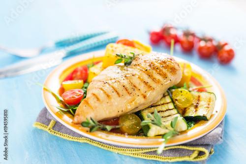 Keuken foto achterwand Kip Grilled chicken breast with vegetables and polenta