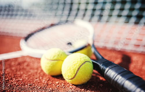 Tennis ball with racket on the tennis court Canvas