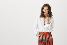 Indoor Shot Of Good-looking Businesswoman In Trendy Outfit, Squinting While Saying Yeah And Beeing Satisfied With Success Or Victory, Standing Over Gray Background. Yes, I Made It All By Myself