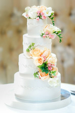 Beautiful Multi-tiered Wedding Cake Decorated With Fresh Flowers