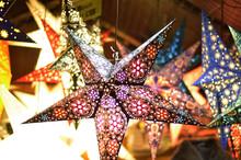 Christmas Stars Hanging On A Stall