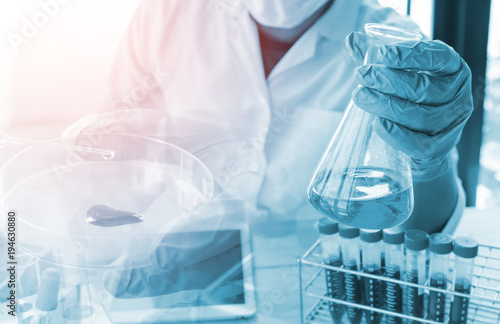 Photo  Vacutainer or test tube in lab on table  scientist hold glass ware