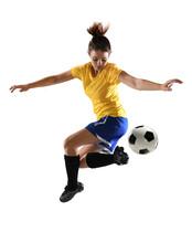 Female Soccer Player Kicking B...